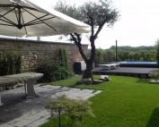 Giardino villa golf vista piscina e veranda